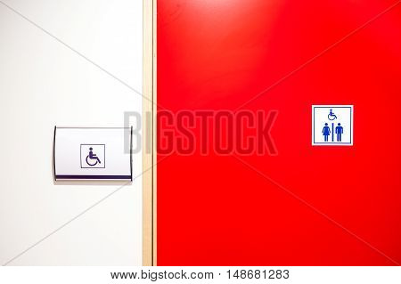 public disabled toilet door in a large building