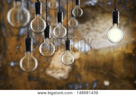 Idea And Leadership Concept Vintage  Bulbs On Wall Background