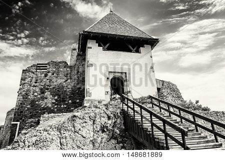 Ruin castle of Visegrad Hungary. Ancient architecture with stairs. Travel destination. Cultural heritage. Black and white photo.