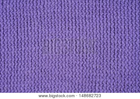 Violet knitted pattern as a seamless background