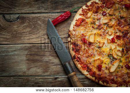 Homemade italian pizza with chicken and mozzarella