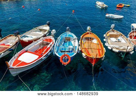 Blue Bay about Manarola and colorful boats in it.