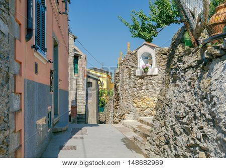 Traditional narrow street in the famous medieval village of Corniglia. Cinque Terre. Italy.