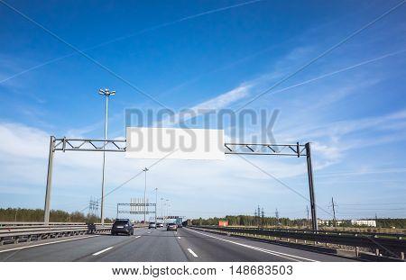 White Information Banner Over Traffic Lanes