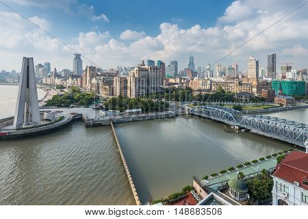Shanghai China - October 23 2013: Aerial view of the Bund with Waibaidu bridge and Monument to the People's Heroes Shanghai China. Shanghai has been developed specifically as a new financial district of China.