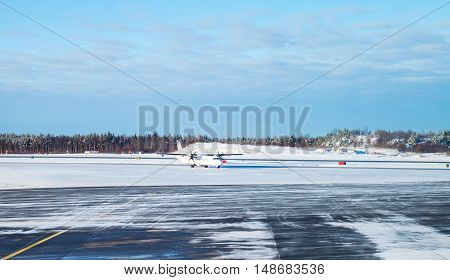 Passenger Plane Goes On Snowy Runway Field
