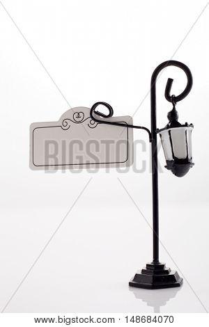 mini sign on the mini lamp pole