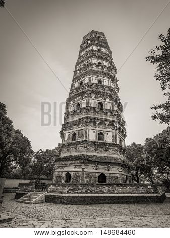 Suzhou, China - October 23,2016: Tiger Hill Pagoda (Yunyan Pagoda) on the Tiger Hill in Suzhou city Jiangsu Province of Eastern China. It is nicknamed the Leaning Tower of China. Black and white photography.