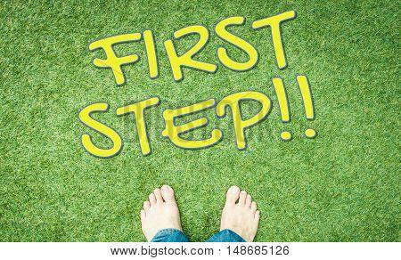 First step bared foot on green grass floor