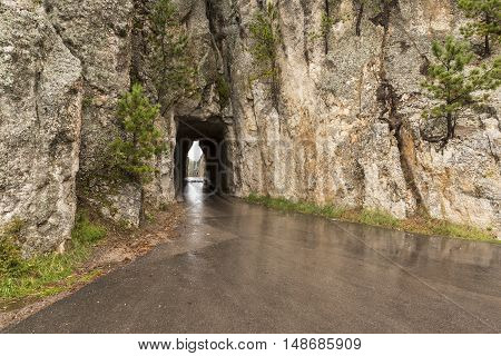 A road passing through a narrow tunnel.