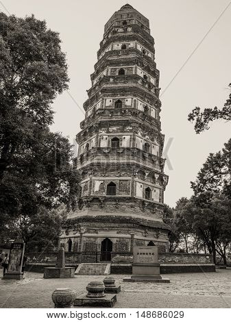 Suzhou China - October 232016: Tiger Hill Pagoda (Yunyan Pagoda) on the Tiger Hill in Suzhou city Jiangsu Province of Eastern China. It is nicknamed the Leaning Tower of China. Black and white photography.