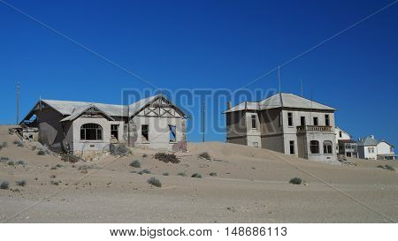 Kolmanskop ghost town sinking in sand sea Namibia