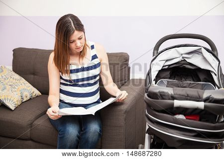 Pregnant Woman Reading Stroller Instructions