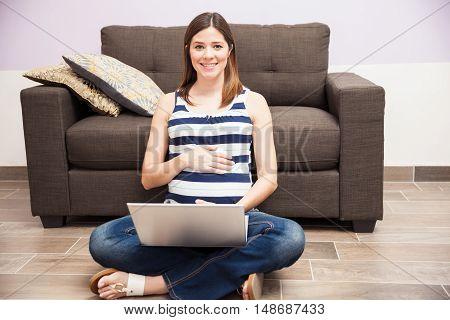 Cute Pregnant Woman Working At Home