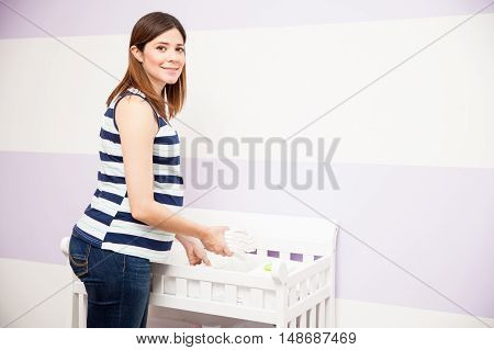 Pregnant Woman Setting A Changing Station