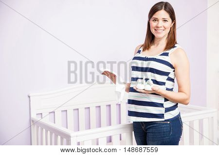 Beautiful Pregnant Woman In A Nursery