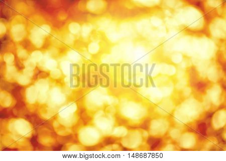Shining out-of-focus highlights in gold and yellow a bright bokeh background ideal for autumn or Christmas