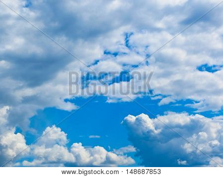 The clouds in the deep blue sky