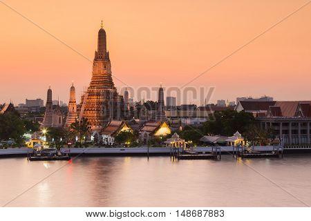Arun temple river front Bangkok landmark at sunset tone, Thailand
