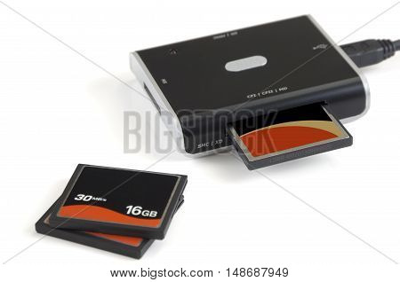 Compact flash and card reader on white background