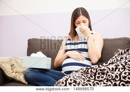 Pregnant Woman Blowing Her Nose