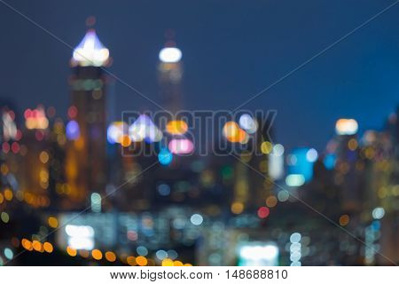 Night blurred ligths city office building and road, abstract background