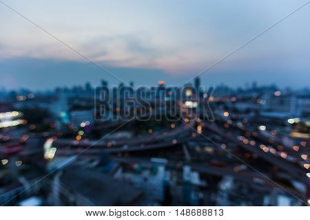 Blurred bokeh lights night view, city and highway road, abstract background