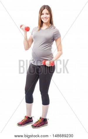 Cute Pregnant Woman Lifting Weights