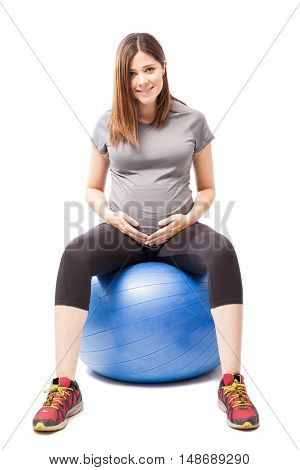 Cute Pregnant Woman In An Exercise Ball