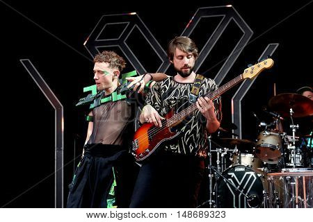 Vocalist Olly Alexander and guitarist Mikey Goldworthy performing with Years & Years at Bestival Festival, September 9th 2016, Newport,  Isle of Wight, UK