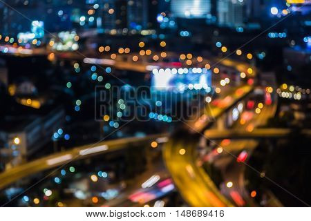 Blurred lights bokeh highway interchanged night view, abstract background