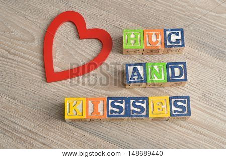 Valentine's Day. Hugs and kisses Spelled with colorful alphabet blocks and a red heart.