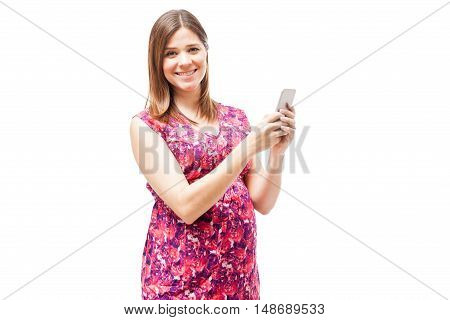 Expectant Mother With A Smartphone