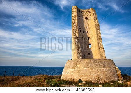 Torre del Serpe (or Torre dell'Idro) at Sunset. An Ancient Roman Lighthouse at Otranto Apulia.