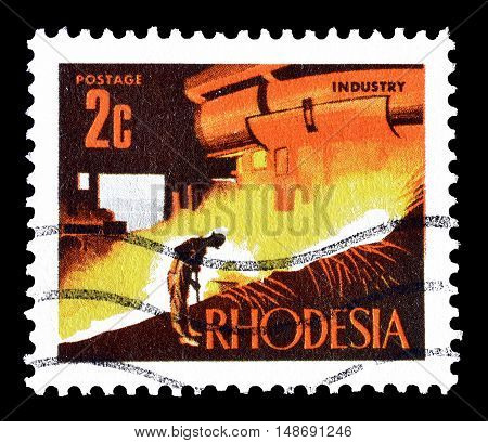 RHODESIA - CIRCA 1970 : Cancelled postage stamp printed by Rhodesia, that shows Blast furnace.