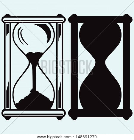 Hourglass. Isolated on blue background. Vector silhouettes