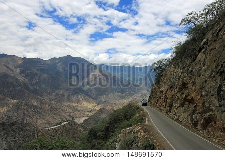 Nice mountain road with nice panorama trough northern Peru near Chachapoyas. You see a van on the road, vanlife.