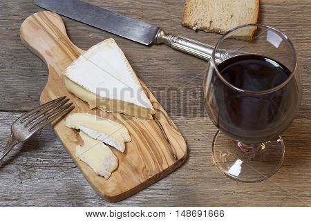 Soft French cheese with the glass of red wine