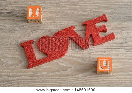 Valentine's Day.I Love U isolated on a wooden background