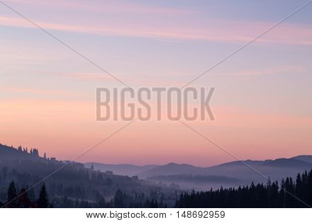Sunrise in the mountains with fog in the valley. Ukrainian Carpathians.