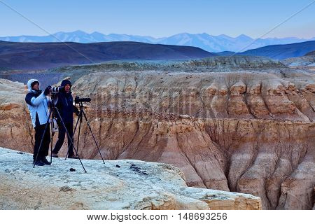ZANDA COUNTY, TIBET - MAY 3, 2013: Touristst poses for a photo in Guge Kingdom, Tibetan Autonomus Region of China. It is the largest clay forest in Tibet.