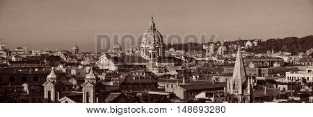 Rome rooftop view with ancient architecture in Italy panorama black and white.