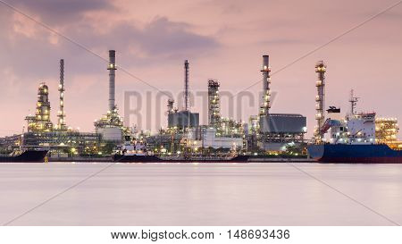 Oil refinery with sunrise sky background, river front
