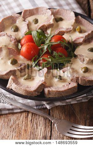 Italian Vitello Tonnato With Tuna Sauce And Capers Close-up. Vertical