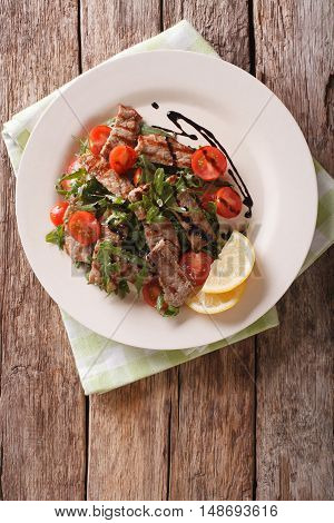 Straccetti Grilled Beef With Arugula And Tomatoes Close-up. Vertical Top View