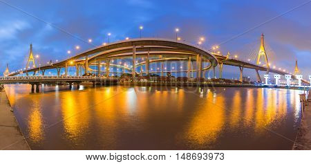 Panorama twin suspension bridge with river reflection and twilight sky background