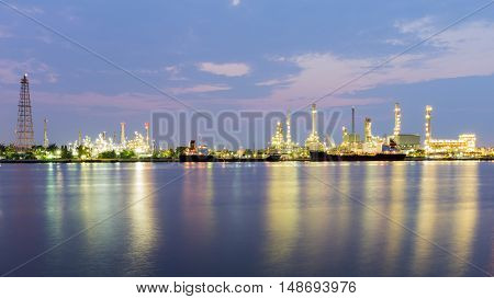 Panorama petrochemical refinery river front with twilight sky background