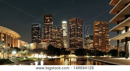 Los Angeles downtown at night with urban buildings and lake