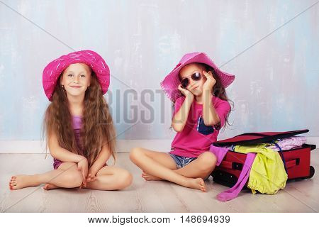 Two beautiful child with very long hair
