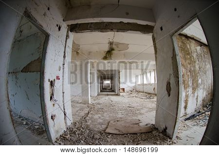 Heavy damage after earthquake abandoned destroyed building  hall rooms